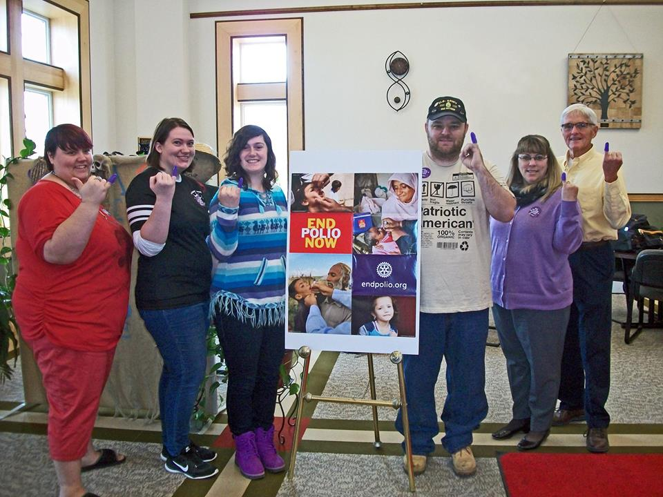 Houlton Center students, Center Director Tracy Rockwell and Otis Smith help stamp out polio!