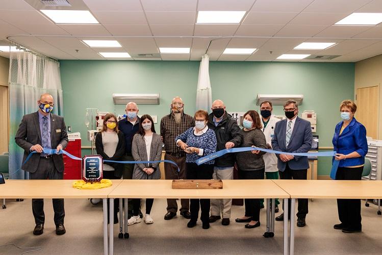 Ribbon cutting during the dedication of the John Lisnik Nursing Simulation Center at UMPI.