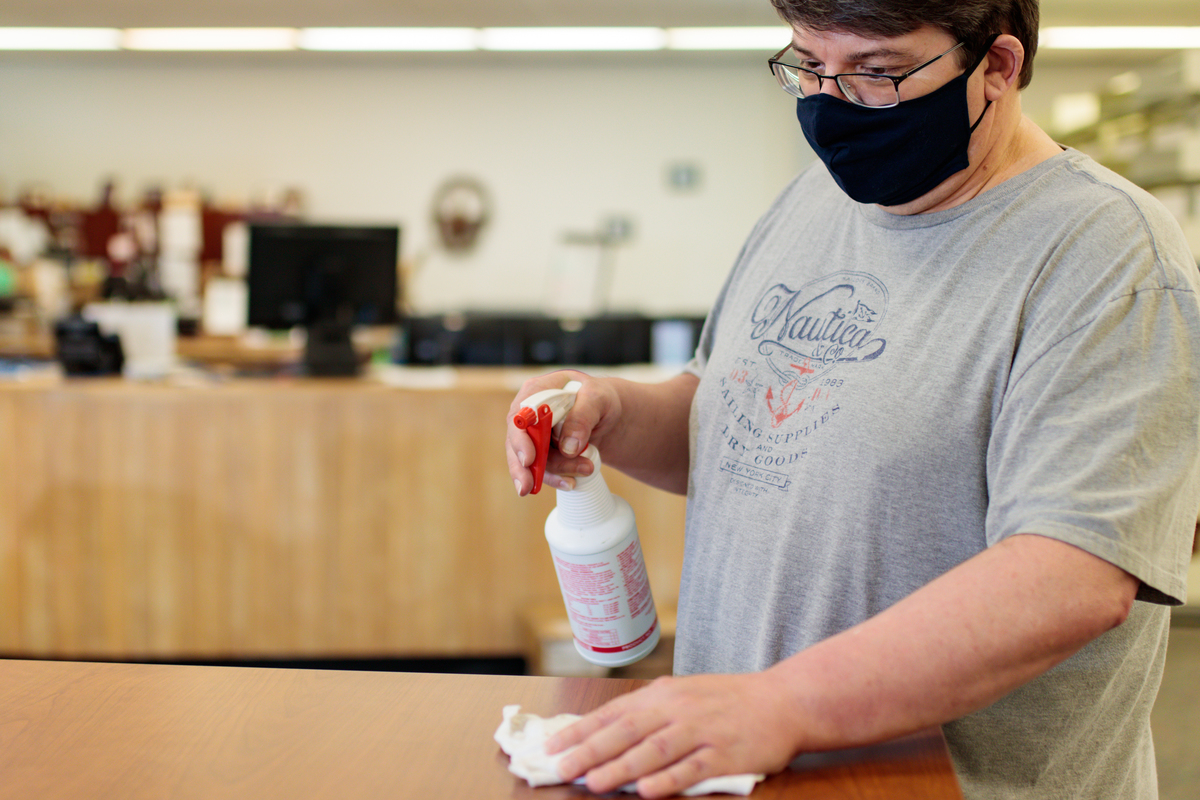 Roger Getz disinfects surfaces at the CIL